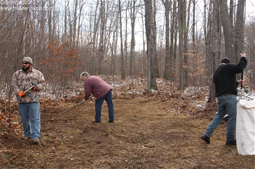 Cleaning up the site with a string trimmer and rakes.pic5a